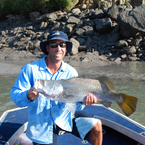 kimberley pearl team member holding caught barramundi