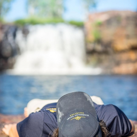 kimberley pearl crew member relaxing by waterfall