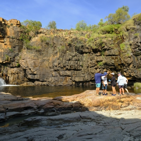 group standing opposite kimberley waterfall