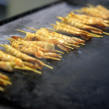 prawn skewers cooking on the bbq