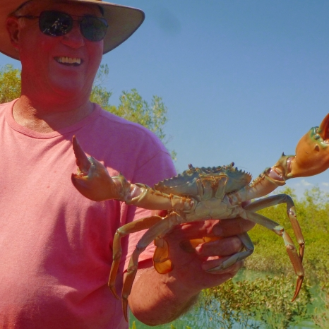 man holding mud crab
