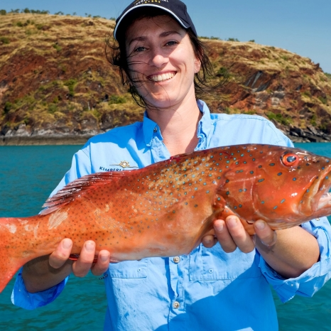 woman holding coral trout