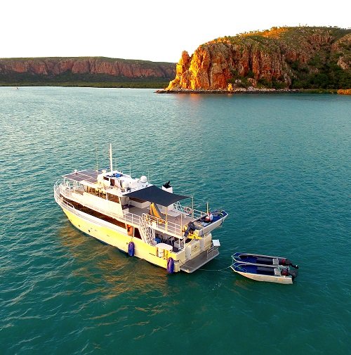 kimberley pearl boat anchored at sunset